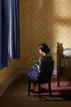Richard Tuschman RETRO WOMEN SITTING WITH PHOTOGRAPH IN BEDROOM Women