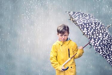 Evelina Kremsdorf ANGRY LITTLE BOY IN RAIN WITH UMBRELLA Children