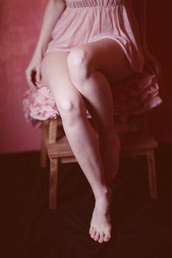 Ilona Shevchishina BAREFOOT GIRL SITTING ON STOOL IN FRILLY DRESS Women