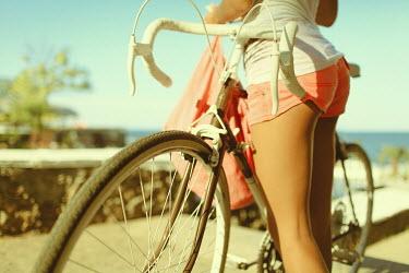Ilona Shevchishina WOMAN IN SHORTS WITH BICYCLE BY SEA Women