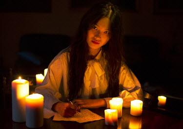 Greta Larosa ASIAN WOMAN WRITING LETTER BY CANDLELIGHT Women