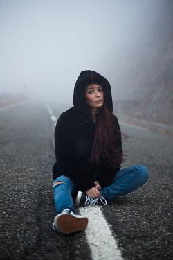 Greta Larosa MODERN WOMAN SITTING ON MISTY ROAD Women
