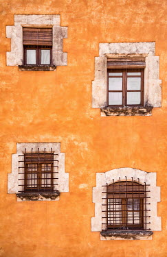 Svetlana Sewell HOUSE WITH ORANGE WALLS AND BARRED WINDOWS Building Detail