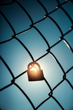 Evelina Kremsdorf SILHOUETTE OF PADLOCK ON FENCE Miscellaneous Objects