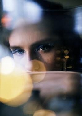 Marta Syrko YOUNG MODERN WOMAN BEHIND LIGHT FLARES Women