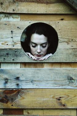 Giovan Battista D'Achille GIRL LOOKING THROUGH HOLE IN WOODEN FENCE Women