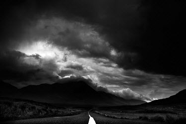 Christine Amat EMPTY ROAD IN STORMY RURAL LANDSCAPE Paths/Tracks