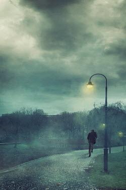 Drunaa MAN RUNNING IN PARK AT NIGHT Men