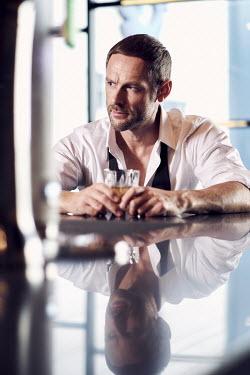 Chris Reeve SERIOUS MAN DRINKING IN BAR Men
