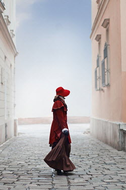 Ildiko Neer Young victorian woman in cobbled town Women