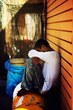Oana Stoian SD BLACK TEENAGE BOY SITTING OUTSIDE Men