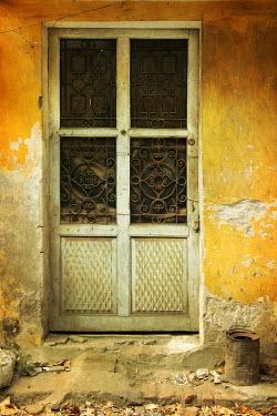 Irene Lamprakou CLOSE UP OF DOOR IN OLD CRUMBLING BUILDING Building Detail