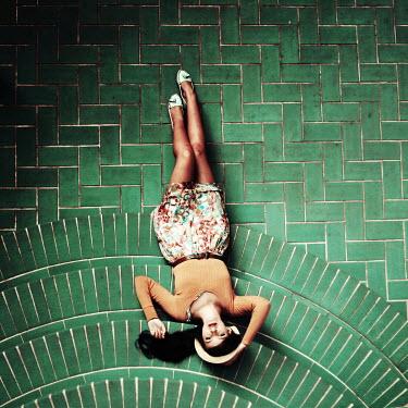 Oana Stoian WOMAN LYING ON GREEN TILED STEPS Women