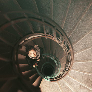 Oana Stoian WOMAN STANDING ON SPIRAL STAIRCASE FROM ABOVE Women