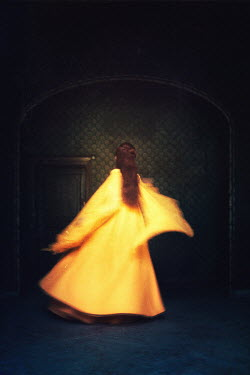 Magdalena Russocka WOMAN IN YELLOW COAT DANCING IN HOUSE Women