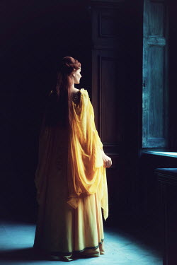 Magdalena Russocka MEDIEVAL WOMAN IN YELLOW DRESS IN HOUSE BY WINDOW Women