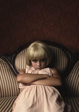 Robin Macmillan SULKY LITTLE BLONDE GIRL ON STRIPED SOFA Children