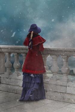 Ildiko Neer VICTORIAN WOMAN ON BALCONY IN SNOW Women