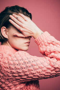 Rekha Garton WOMAN IN PINK SWEATER COVERING FACE Women
