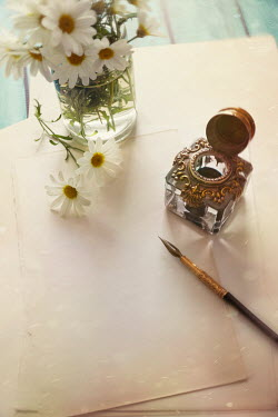 Sandra Cunningham INKWELL, PEN AND PAPER ON TABLE WITH FLOWERS Flowers