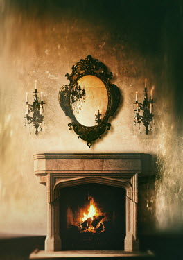 Sandra Cunningham FIREPLACE WITH FIRE, MIRROR AND CANDLES Interiors/Rooms