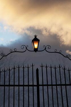 Yolande de Kort OLD GATE WITH LANTERN AT NIGHT Gates