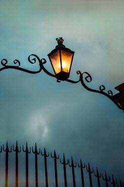 Yolande de Kort VICTORIAN GATE WITH LANTERN AT NIGHT Gates