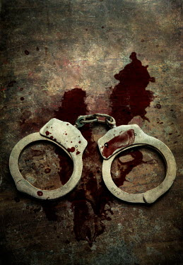 Jaroslaw Blaminsky CLOSE UP OF BLOODY METAL HANDCUFFS Miscellaneous Objects