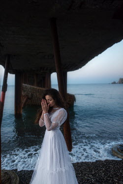 Tatiana Mertsalova WOMAN UNDER PIER IN WHITE DRESS Women