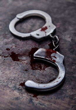 Jaroslaw Blaminsky CLOSE UP OF BLOODY HANDCUFFS Miscellaneous Objects