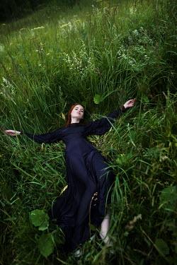 Tatiana Mertsalova WOMAN LYING IN GRASS Women