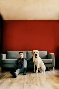 Krasimira Petrova Shishkova GIRL WITH DOG SITTING BESIDE SOFA Women