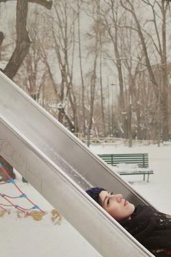 Giovan Battista D'Achille WOMAN LYING ON SLIDE IN WINTER Women