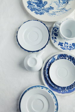 Isabelle Lafrance WHITE AND BLUE CHINA ON WHITE TABLECLOTH Miscellaneous Objects