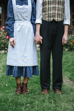 Magdalena Russocka RETRO COUPLE HOLDING HANDS IN GARDEN Couples