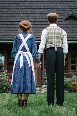 Magdalena Russocka RETRO COUPLE HOLDING HANDS OUTSIDE HOUSE Couples