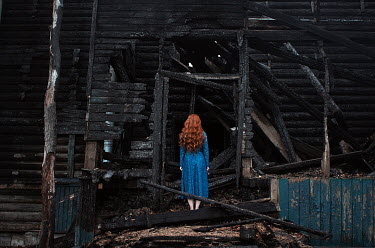 Alexandra Bochkareva WOMAN WITH RED HAIR IN BURNT BUILDING Women