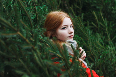 Alexandra Bochkareva WOMAN WITH RED HAIR LYING IN FIR TREES Women