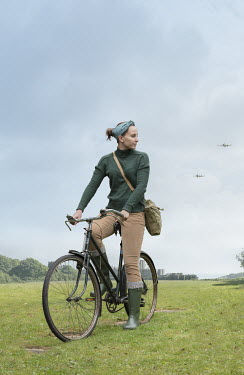 Stephen Mulcahey WARTIME GIRL RIDING BICYCLE WITH AEROPLANES Women