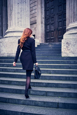 Chris Reeve BUSINESS WOMAN ON STEPS OF GRAND BUILDING Women