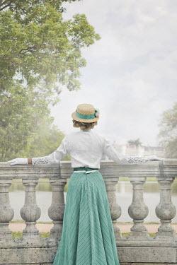 Ildiko Neer Edwardian woman on grand balcony at lake Women