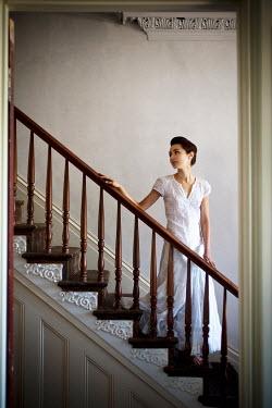 Joshua Sheldon GIRL IN WHITE ON STAIRCASE OF OLD HOUSE Women
