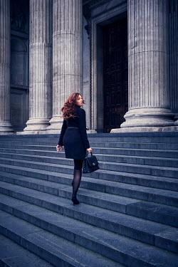 Chris Reeve WOMAN WALKING UP STONE STEPS Women