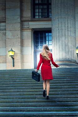 Yolande de Kort MODERN WOMAN ON STEPS BY GRAND BUILDING Women