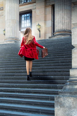 Yolande de Kort BLONDE WOMAN ON STEPS OF GRAND BUILDING Women