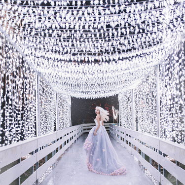Jovana Rikalo YOUNG WOMAN UNDER CANOPY OF LIGHTS Women