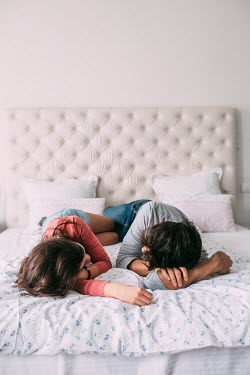 Jovana Rikalo YOUNG COUPLE LYING ON BED Couples