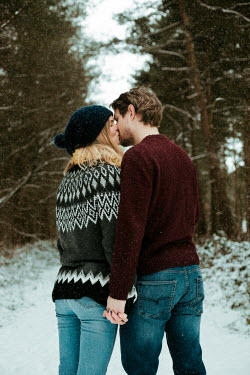 Laura Ranftler YOUNG COUPLE KISSING IN SNOW Couples
