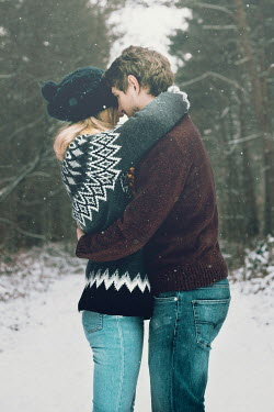 Laura Ranftler COUPLE HUGGING IN SNOW Couples
