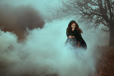 Monica Lazar WOMAN WEARING CAPE IN FOG Women